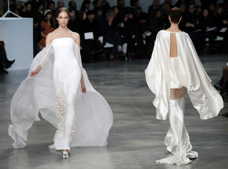 Let's focus for a moment on the dress on the right. Of all the parts of your body that the world needs to see more of, have you ever once chosen just the upper thigh? Models present creations by French fashion designer Stephane Rolland  for his Spring Summer 2013 Haute Couture fashion collection, presented in Paris, Tuesday, Jan. 22.   Photo: Christophe Ena, Associated Press / AP