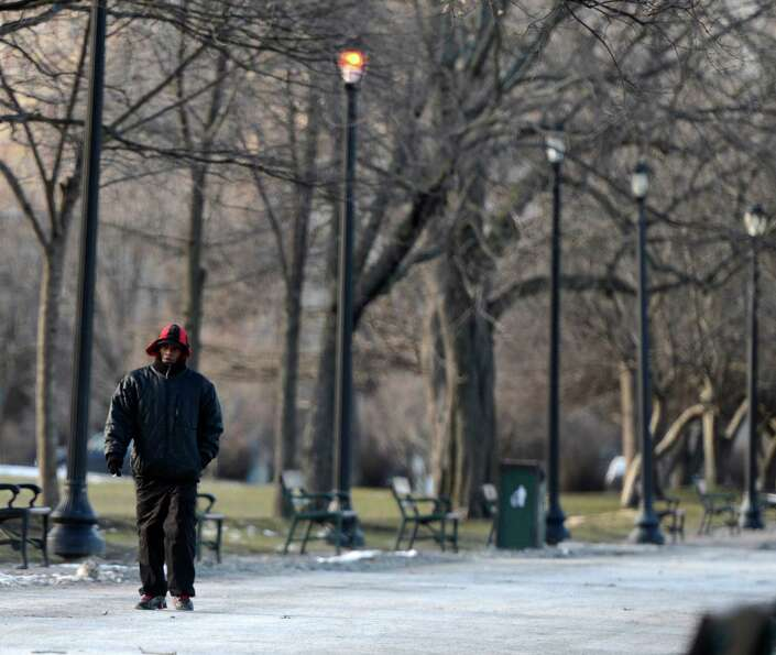 A man braves the wind and cold as he walks in Washington Park on Tuesday, Jan. 22, 2013 in Albany, N