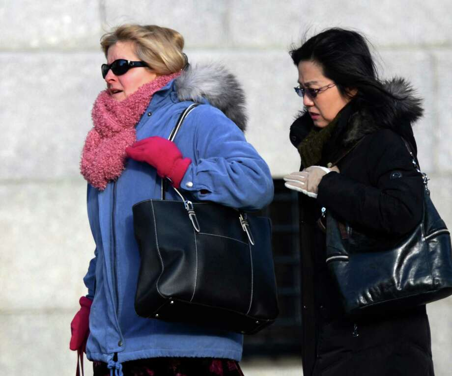 Two women fight the wind and cold on Eagle Street in Albany on Tuesday, Jan. 22, 2013.  (Skip Dickstein/Times Union) Photo: SKIP DICKSTEIN