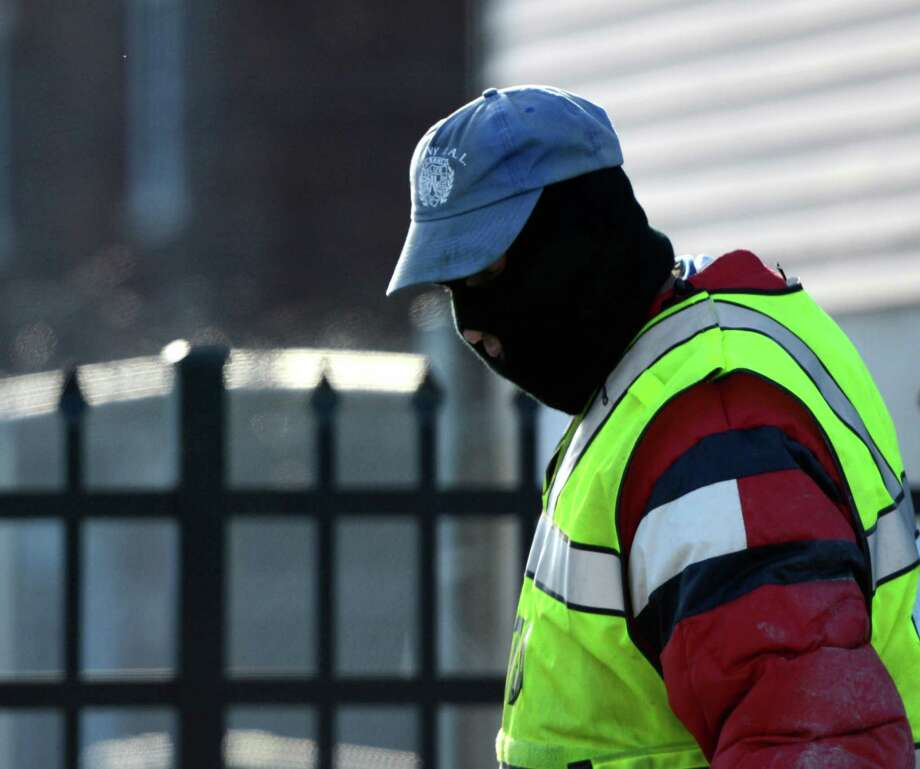 Thomas Riddick of the Clean Team deals with the wind and cold as he works to keep the city streets clear on Tuesday, Jan. 22, 2013 in Albany, N.Y.  (Skip Dickstein/Times Union) Photo: SKIP DICKSTEIN