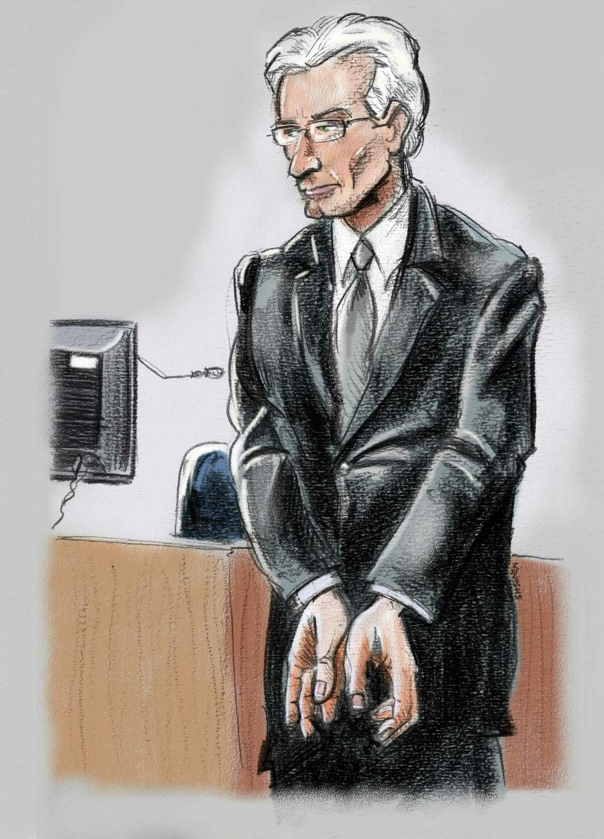 Former Stanford CFO James Davis, replicating for jurors the handcuffing motion he used to make to warn R. Allen Stanford that what they were doing was illegal Thursday, February. 2, 2012 in Houston, Texas. Davis, who pled guilty for his part in a $7 billion Ponzi scheme headed by Stanford, testified against the flamboyant Texas tycoon during Stanford?'s fraud trial in Houston on Thursday. (Ken Ellis/Houston Chronicle)