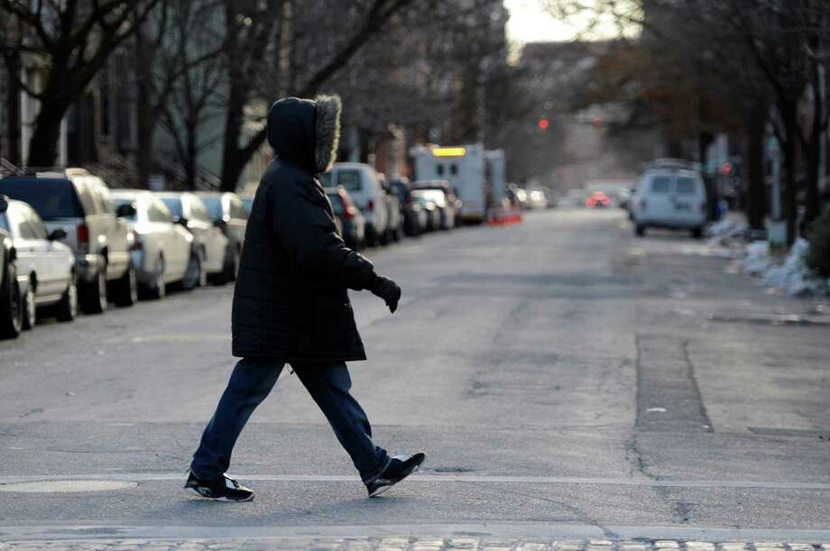 A person is bundled up from wind and cold on State Street Jan. 22, 2013,  in Albany, N.Y.  (Skip Dickstein/Times Union) Photo: SKIP DICKSTEIN, ALBANY TIMES UNION
