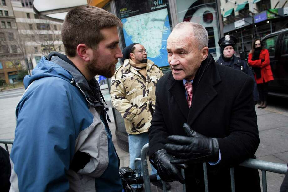 New York Police Commissioner Ray Kelly chats with a man at the One Million Moms for Gun Control Rally outside City Hall park, Jan. 21, 2012, in New York. Demonstrators called for new gun control legislation with a march over the Brooklyn bridge and a rally at City Hall Park. Photo: John Minchillo, AP / FR170537 AP