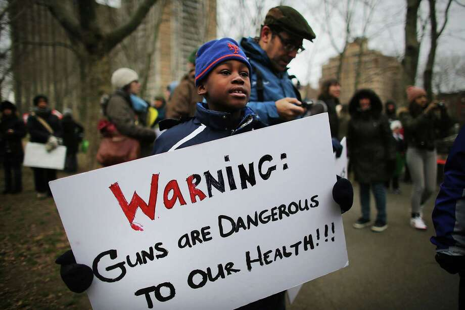 NEW YORK, NY - JANUARY 21:  Ellis Windheim, age 8, participates in a rally and march across the Brooklyn Bridge with One Million Moms for Gun Control, a gun control group formed in the wake of last month's massacre at a Newtown, Connecticut elementary school on January 21, 2013 in New York City. The group marched to City Hall where they held a rally and demanded stricter measures against guns. One Million Moms for Gun Control said the event is inspired by the Rev. Martin Luther King Jr.'s message of nonviolence. Photo: Spencer Platt, Getty Images / 2013 Getty Images