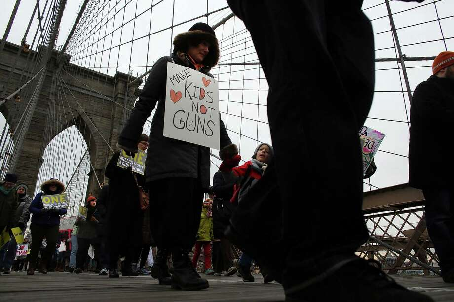 NEW YORK, NY - JANUARY 21:  Participants with One Million Moms for Gun Control, a gun control group formed in the wake of last month's massacre at a Newtown, Connecticut elementary school, holds a rally and march across the Brooklyn Bridge on January 21, 2013 in New York City.  The group marched to City Hall where they held a rally and demanded stricter measures against guns. One Million Moms for Gun Control said the event is inspired by the Rev. Martin Luther King Jr.'s message of nonviolence. Photo: Spencer Platt, Getty Images / 2013 Getty Images