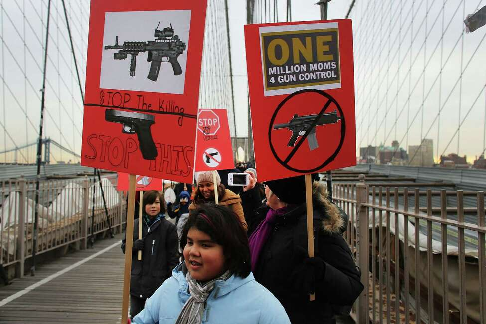 NEW YORK, NY - JANUARY 21: Participants with One Million Moms for Gun Control, a gun control group formed in the wake of last month's massacre at a Newtown, Connecticut elementary school, attend a rally and march across the Brooklyn Bridge on January 21, 2013 in New York City. The group marched to City Hall where they held a rally and demanded stricter measures against guns. One Million Moms for Gun Control said the event is inspired by the Rev. Martin Luther King Jr.'s message of nonviolence.