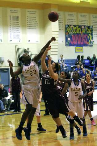 Clemens sophomore post Ka'Resha Grant (23) blocks a shot by Lockhart's Mikaela Ramirez during the Lady Buff's 69-34 home win Friday, running their 27-4A record to a perfect 9-0. Photo: Greg Bell /for The NE Herald
