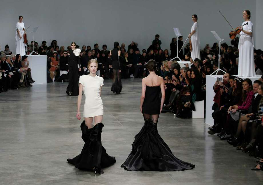 It gets even better when you do the bottom half in black. It looks like she's dragging around a garbage bag, which is magically clinging to her legs via static electricity. A model presents a creation by French fashion designer Stephane Rolland  for his Spring Summer 2013 Haute Couture fashion collection, presented in Paris, Tuesday, Jan. 22. Photo: Christophe Ena, Associated Press / AP