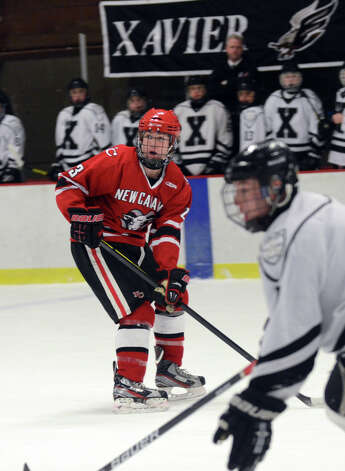 New Canaan's Luke Amero (23) waits for a pass during the boys hockey game against Xavier at the Freeman Athletic Center in Middletown on Monday, Jan. 21, 2013. Photo: Amy Mortensen / Connecticut Post Freelance