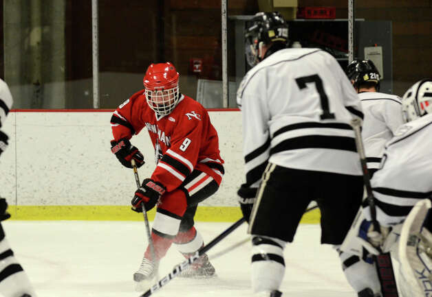 New Canaan's Peter Reinhardt (9) controls the puck during the boys hockey game against Xavier at the Freeman Athletic Center in Middletown on Monday, Jan. 21, 2013. Photo: Amy Mortensen / Connecticut Post Freelance