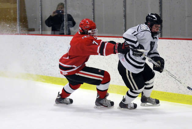 New Canaan's Benjamin Patch (7) checks Xavier's Dan Dupont (11) during the boys hockey game at the Freeman Athletic Center in Middletown on Monday, Jan. 21, 2013. Photo: Amy Mortensen / Connecticut Post Freelance