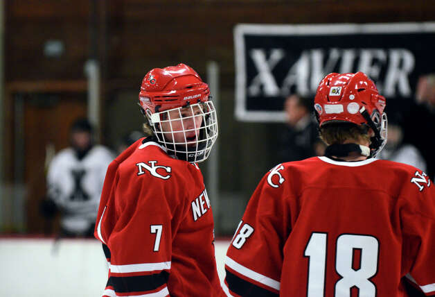 New Canaan's Benjamin Patch (7) and Peter Richardoson (18) on the ice during the boys hockey game against Xavier at the Freeman Athletic Center in Middletown on Monday, Jan. 21, 2013. Photo: Amy Mortensen / Connecticut Post Freelance