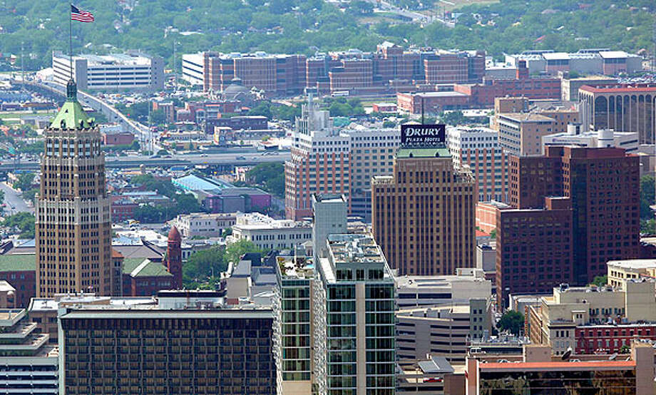 The San Antonio skyline looking from the east side toward the west is seen in this April 10, 2012 aerial photo.  Photo: William Luther, San Antonio Express-News / © 2012 WILLIAM LUTHER