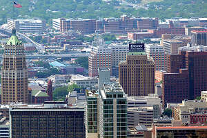 The San Antonio skyline looking from the east side toward the west is seen in this April 10, 2012 aerial photo. (William Luther/wluther@express-news.net)