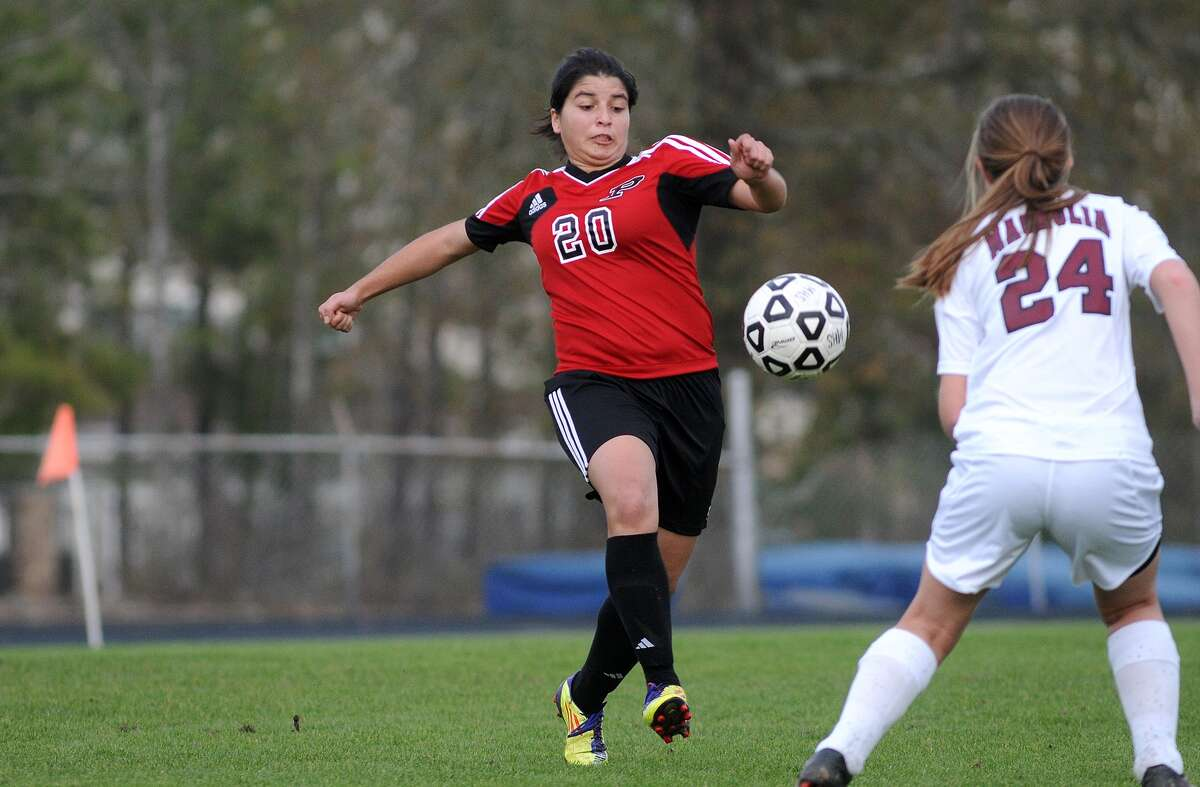Porter's Leticia Ball, from left, controls the ball against Magnolia senior midfielder Heather Rochester during the championship game of the Porter Prepare for Glory tournament at Don Ford Stadium. Freelance photo by Jerry Baker
