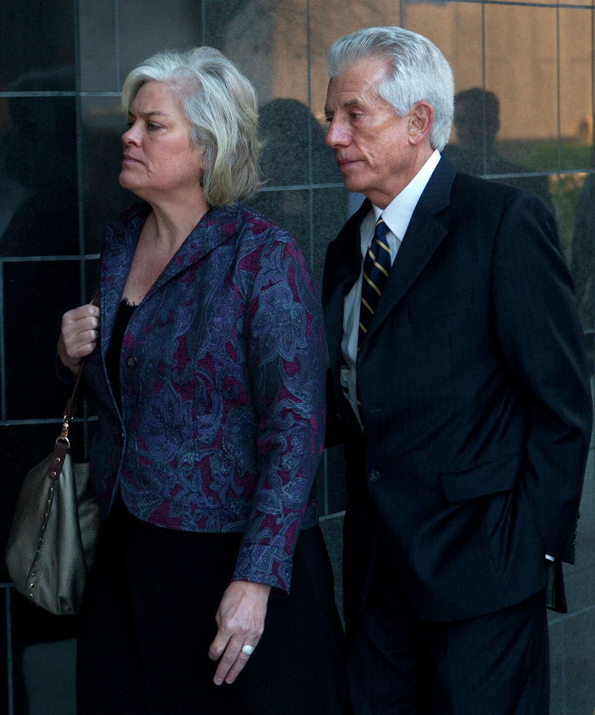 James Davis, right, enters the Federal Courthouse with his wife, Lori, Tuesday, Jan. 22, 2013, in Houston. Davis, who testified against Allen Stanford, will receive his sentence today. He could face up to th 30 years for his role in one of the biggest Ponzi schemes in U.S. History.