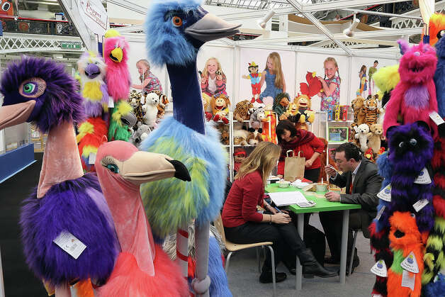 People work on a trade stand during the 2013 London Toy Fair at Olympia Exhibition Centre on January 22, 2013 in London, England. The annual fair which is organized by the British Toy and Hobby Association, brings together toy manufacturers and retailers from around the world. Photo: Dan Kitwood, Getty Images / 2013 Getty Images