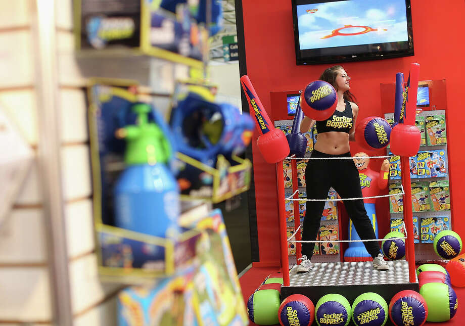 A woman works out on a trade stand during the 2013 London Toy Fair at Olympia Exhibition Centre on January 22, 2013 in London, England. The annual fair which is organized by the British Toy and Hobby Association, brings together toy manufacturers and retailers from around the world. Photo: Dan Kitwood, Getty Images / 2013 Getty Images