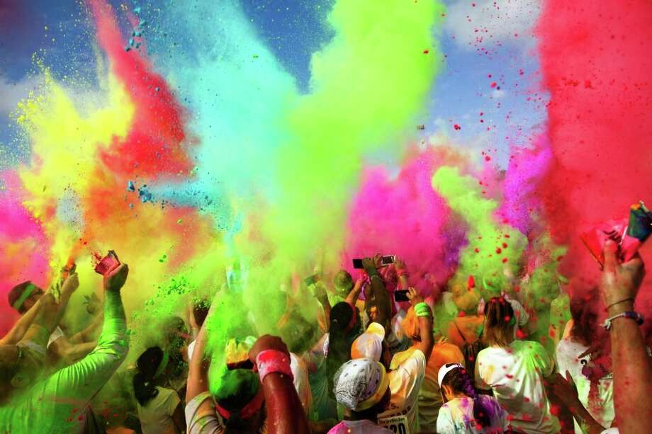 Colored powder showers at Houston's Graffiti Run. Courtesy photo Photo: Courtesy Photo