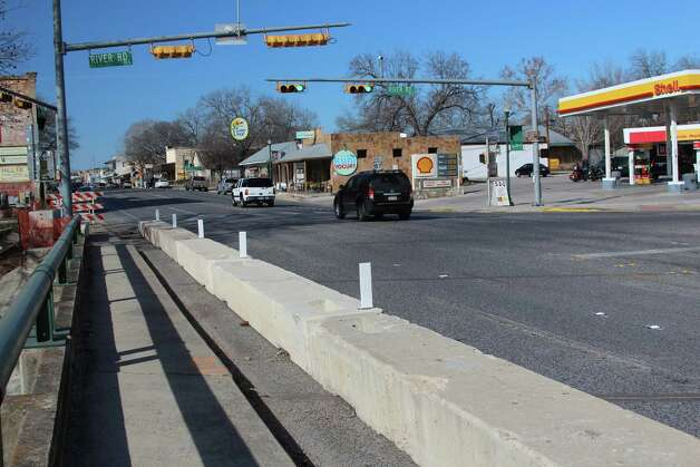 Barriers have been placed along Main Street in Boerne at the  the Cibolo Creek Bridge, which will be widened with additional pedestrian walkways and other amenities. The reconstruction will creroute auto traffic from 11 p.m. to 5 a.m. Sunday through Thursday nights as beams are placed for new portions of an expansion of the existing bridge. Photo: Lauri Gray Eaton / Northwest Wee