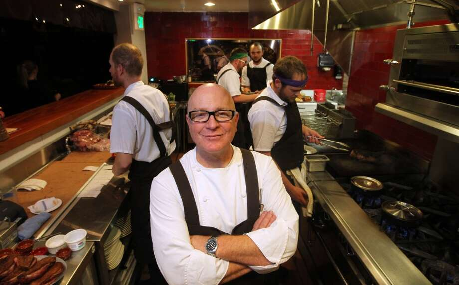 Chef Paul Canales stands in the middle of his open kitchen at his new restaurant Duende. Canales, formerly of Oliveto has opened in downtown Oakland at 468 19th St.