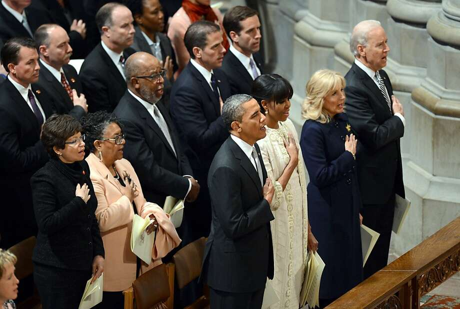 (Front Left to right) US President Barack Obama, First Lady Michelle Obama, Dr. Jill Biden and Vice President Biden and his wife sing the US National Anthem during a prayer service at Washington National Cathedral on January 22, 2013 in Washington, DC. Photo: Saul Loeb, AFP/Getty Images