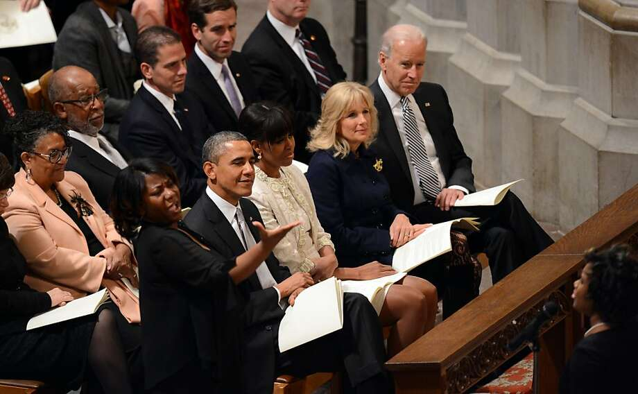 (Front Left to right) President Barack Obama, First Lady Michelle Obama, Dr. Jill Biden and Vice President Biden  listen to the choir as they attend a prayer service at Washington National Cathedral on January 22, 2013 in Washington, DC.  Photo: Saul Loeb, AFP/Getty Images