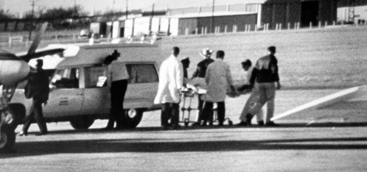 The body of former President Lyndon Johnson is placed in an Army ambulance at the San Antonio International Airport January 22, 1973.