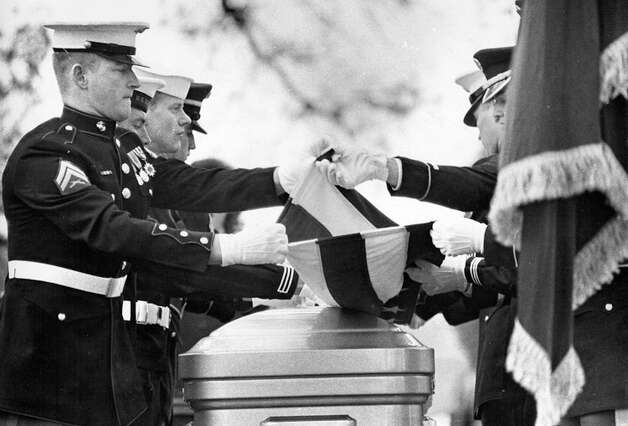 Members of the honor guard at Lyndon Johnson's fuenral fold the American flag during burial services in January 1973. Photo: Express-News File Photo