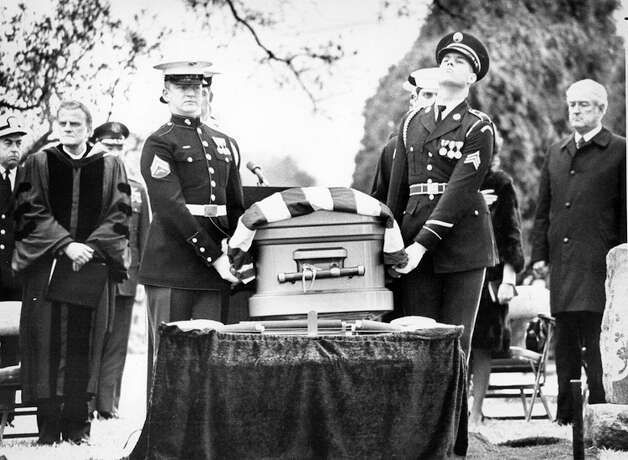 The casket of Lyndon Johnson is carried by an honor guard past Billy Graham and former Texas governor John Connally during services in January 1973. Photo: Express-News File Photo