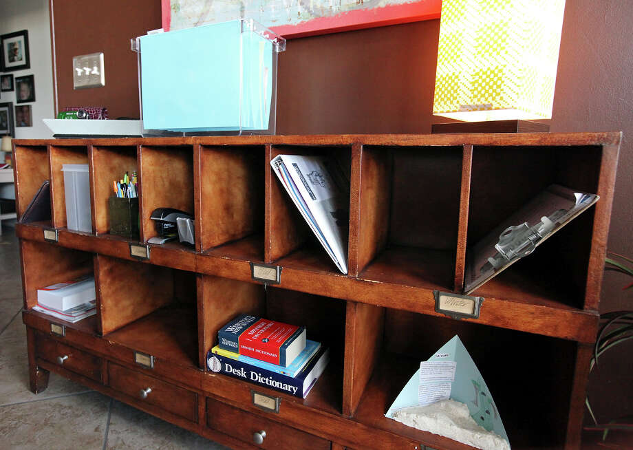Karen Meade and her family stash items they grab every day in cubbies in the family's landing zone. Photo: Edward A. Ornelas, San Antonio Express-News / © 2012 San Antonio Express-News