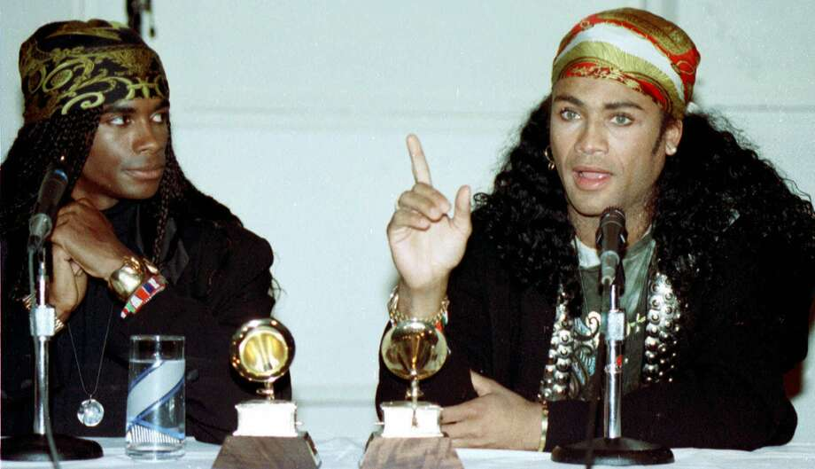 Rob Pilatus joined Fabrice Morvan in 1988 to form Milli Vanilli. The group's songs flew up the charts in the late 80s and 90s only to crash when they had their Grammy taken back when it was revealed that the lead vocals of their hit song 'Girl You Know It's True' weren't theirs and that they lip-synched all their performances. Pilatus died in 1998 at 32.In this file photo Fabrice Morvan, left, and Rob Pilatus of Milli Vanilli talk to the media