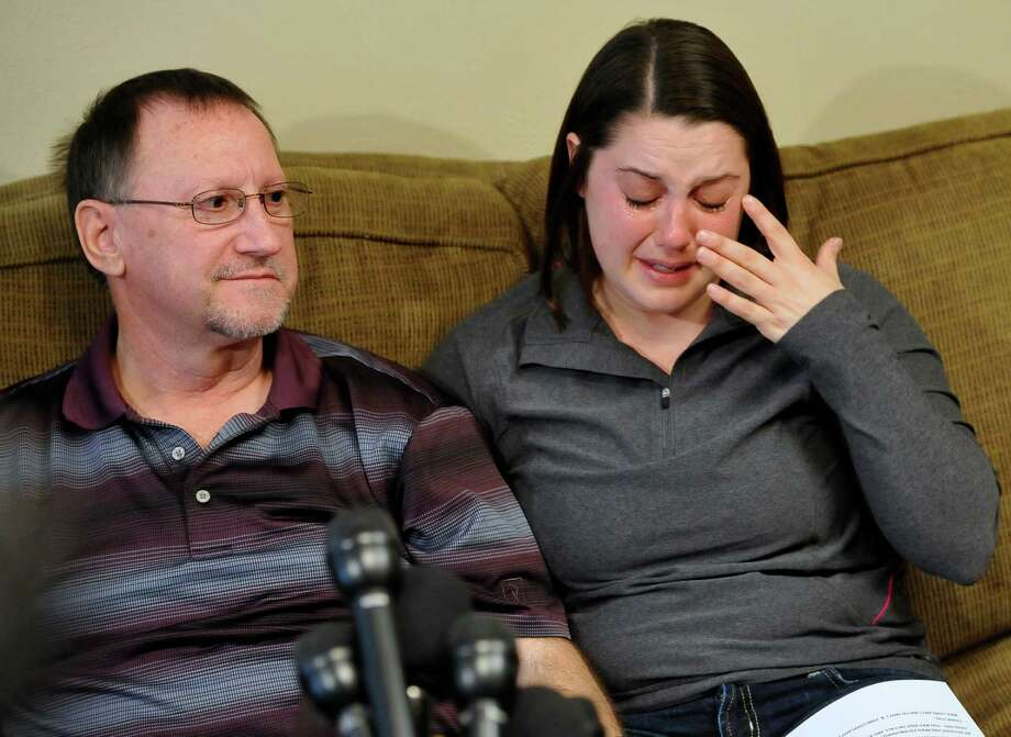 Mike Lovelady, left,  held a formal press conference Tuesday morning January 22, 2013 about the death of his brother Victor Lynn Lovelady at the hands of terrorists in Algeria. Victor Lovelady's daughter Erin, right, was also there and spoke about her dad. It was held at the home of Mike Lovelady in Nederland Texas.   Dave Ryan/The Enterprise Photo: Dave Ryan