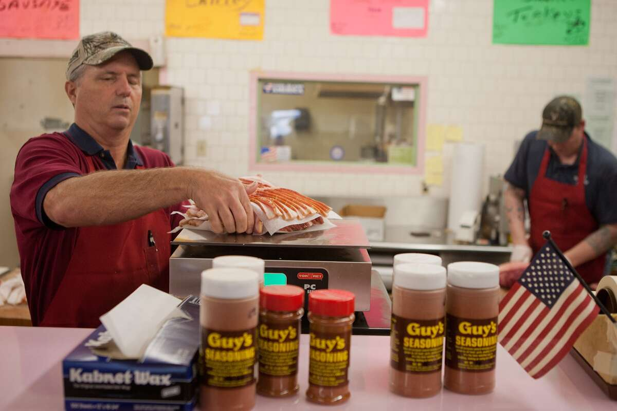 Steve Fee weighs an order at Guy's Meat Market, which has operated since 1958 from 3106 Old Spanish Trail. The original Guy's Market started in 1938 on Almeda near Hermann Park.