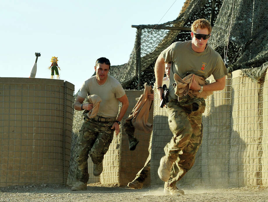 Prince Harry (R)  races out from the VHR (very high ready-ness) tent to scramble his Apache with fellow pilots, during his 12 hour shift at the British controlled flight-line in Camp Bastion on November 3, 2012 in Afghanistan. Prince Harry has served as an Apache Helicopter Pilot/Gunner with 662 Sqd Army Air Corps, from September 2012 for four months until January 2013. Photo: WPA Pool, Getty Images / 2012 Getty Images