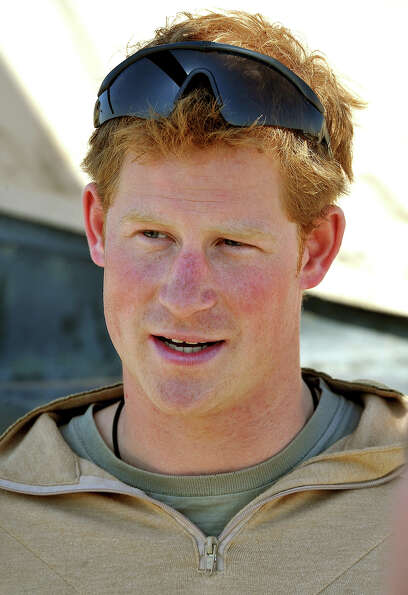Prince Harry  gives a TV interview by his Helicopter at the British controlled flight-line in Camp B