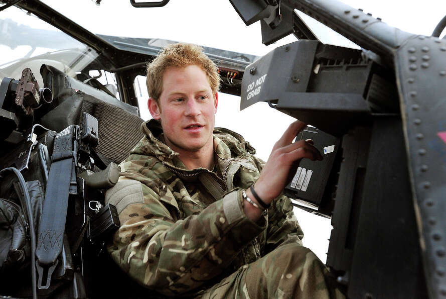Prince Harry makes early morning checks as he sits on an Apache helicopter at the British controlled