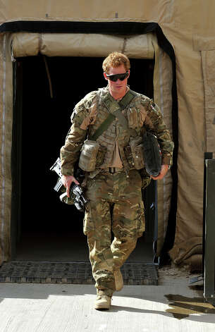 Prince Harry walks through the British controlled flight-line in Camp Bastion on October 31, 2012 in Afghanistan. Prince Harry has served as an Apache Helicopter Pilot/Gunner with 662 Sqd Army Air Corps, from September 2012 for four months until January 2013. Photo: WPA Pool, Getty Images / 2012 Getty Images
