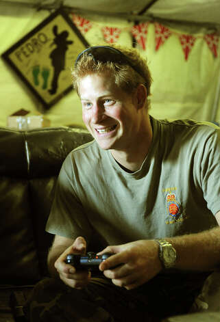 Prince Harry (foreground) relaxes during a computer football game with his fellow Apache Helicopter pilot Capt Simon Beattie, during their 12 hour VHR (very high ready-ness) shift at the British controlled flight-line in Camp Bastion on November 3, 2012 in Afghanistan. Prince Harry has served as an Apache Helicopter Pilot/Gunner with 662 Sqd Army Air Corps, from September 2012 for four months until January 2013. Photo: WPA Pool, Getty Images / 2013 Getty Images