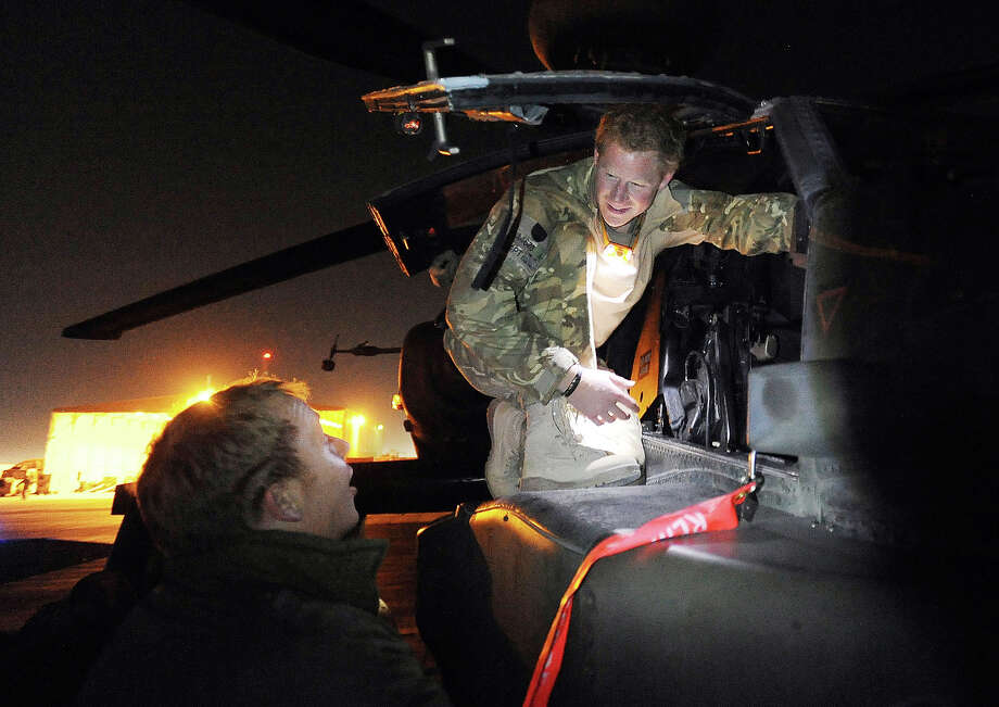 Prince Harry, as he is known in the British Army, inspects his Apache Helicopter before lift off on a night mission from Camp Bastion on December 10, 2012 in Afghanistan, where he has served as an Apache Helicopter Pilot/Gunner with 662 Sqd Army Air Corps, from September 2012 for four months until January 2013. Photo: WPA Pool, Getty Images / 2012 Getty Images