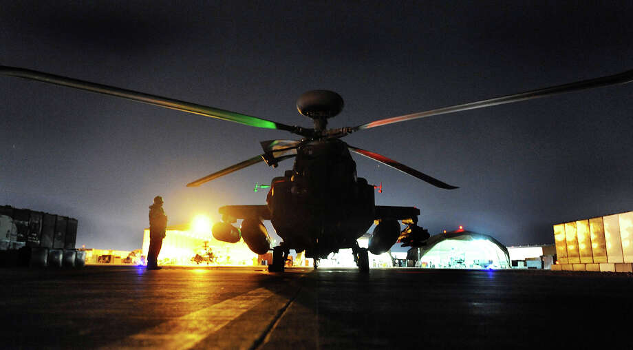 The Apache Helicopter co-piloted by Prince Harry stands before lift off on a night mission from Camp Bastion on December 11, 2012 in Afghanistan. Prince Harry has served as an Apache Helicopter Pilot/Gunner with 662 Sqd Army Air Corps, from September 2012 for four months until January 2013. Photo: WPA Pool, Getty Images / 2012 Getty Images