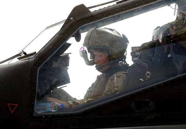 Prince Harry sits in the front cockpit of an Apache helicopter at the British controlled flight-line in Camp Bastion on October 31, 2012 in Afghanistan. Prince Harry has served as an Apache Helicopter Pilot/Gunner with 662 Sqd Army Air Corps, from September 2012 for four months until January 2013. Photo: WPA Pool, Getty Images / 2012 Getty Images