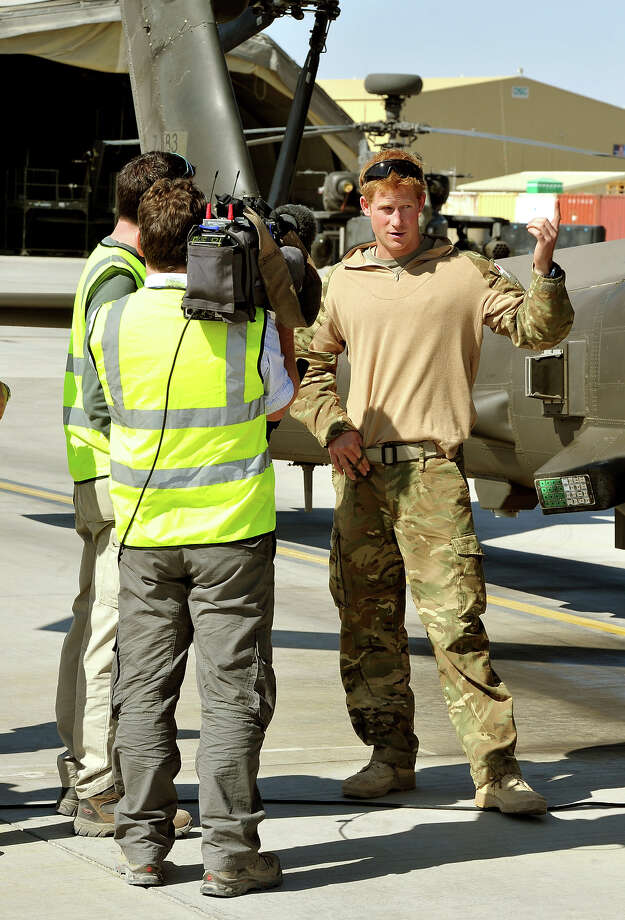 Prince Harry gives a TV interview by his Helicopter at the British controlled flight-line in Camp Bastion southern Afghanistan, where he has served as an Apache Helicopter Pilot/Gunner with 662 Sqd Army Air Corps, from September 2012 for four months until January 2013. Photo: WPA Pool, Getty Images / 2012 Getty Images