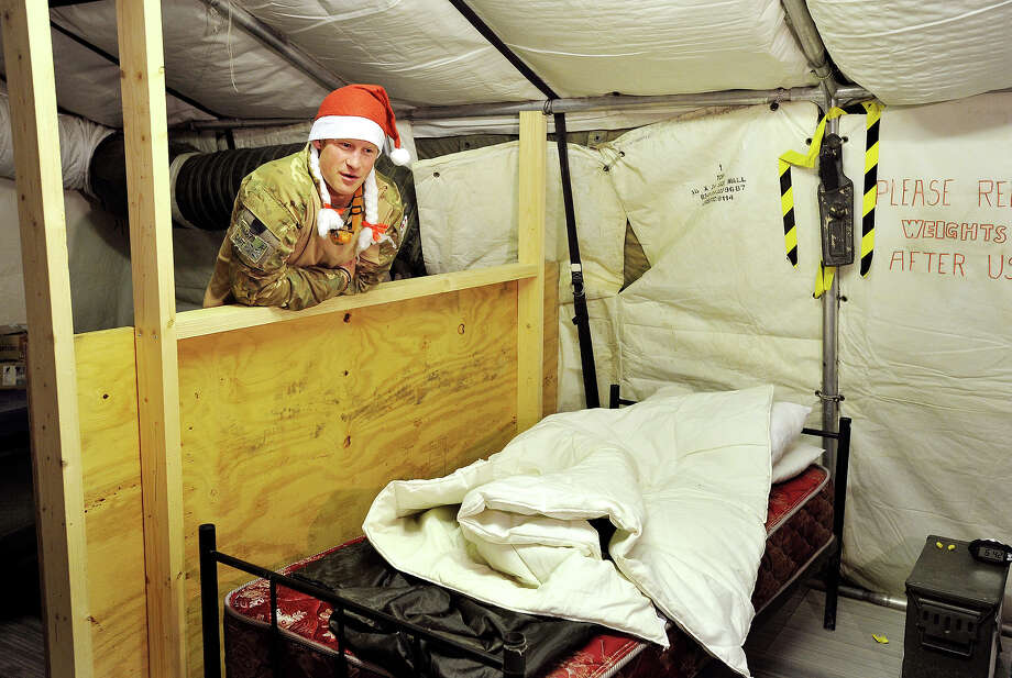Prince Harry, shows a television crew his sleeping area and bed at the VHR (very high readiness) tent close to the flight-line at the British controlled flight-line at Camp Bastion on December 12, 2012 in Afghanistan. Prince Harry has served as an Apache Helicopter Pilot/Gunner with 662 Sqd Army Air Corps, from September 2012 for four months until January 2013. Photo: WPA Pool, Getty Images / 2013 Getty Images