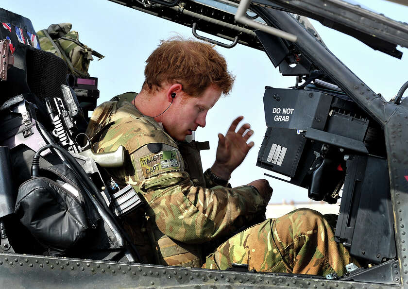 Prince Harry sits in the front seat of his cockpit in Camp Bastion on October 31, 2012 in Afghanista