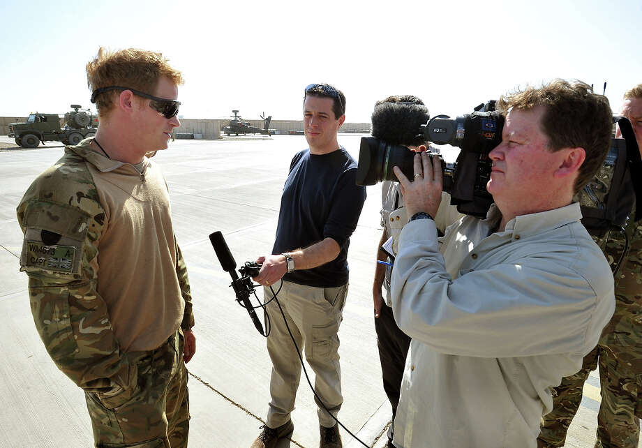 Prince Harry gives a television interview beside his Helicopter at the British controlled flight-line in Camp Bastion on November 1, 2012 in Afghanistan. Prince Harry has served as an Apache Helicopter Pilot/Gunner with 662 Sqd Army Air Corps, from September 2012 for four months until January 2013. Photo: WPA Pool, Getty Images / 2012 Getty Images