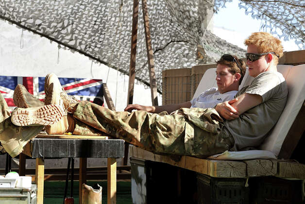 Prince Harry (right) relaxes with fellow Pilots in their VHR (very high ready-ness) at the British controlled flight-line in Camp Bastion southern Afghanistan, where he has served as an Apache Helicopter Pilot/Gunner with 662 Sqd Army Air Corps, from September 2012 for four months until January 2013. Photo: WPA Pool, Getty Images / 2012 Getty Images