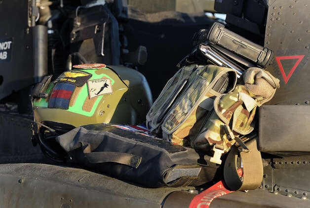 Prince Harry places his crash helmet beside his Apache helicopter before a flight at the British controlled flight-line in Camp Bastion on November 1, 2012 in Afghanistan. Prince Harry has served as an Apache Helicopter Pilot/Gunner with 662 Sqd Army Air Corps, from September 2012 for four months until January 2013. Photo: WPA Pool, Getty Images / 2012 Getty Images