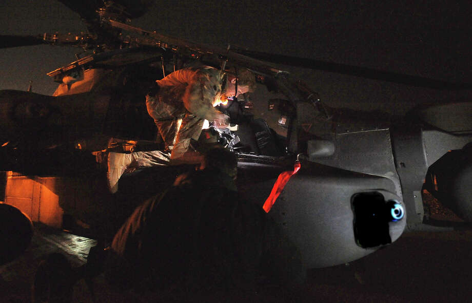 Prince Harry inspects his Apache helicopter before lift off on a night mission from Camp Bastion on December 10, 2012 in Afghanistan. Prince Harry has served as an Apache Helicopter Pilot/Gunner with 662 Sqd Army Air Corps, from September 2012 for four months until January 2013. Photo: WPA Pool, Getty Images / 2012 Getty Images