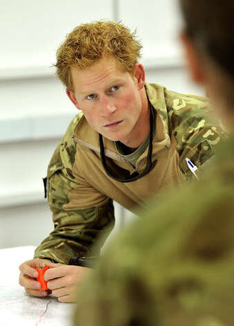 Prince Harry attends a mission briefing at the British controlled flight-line at Camp Bastion on November 1, 2012 in Afghanistan. Prince Harry has served as an Apache Helicopter Pilot/Gunner with 662 Sqd Army Air Corps, from September 2012 for four months until January 2013. Photo: WPA Pool, Getty Images / 2013 Getty Images